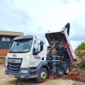 road sweeper disposing waste